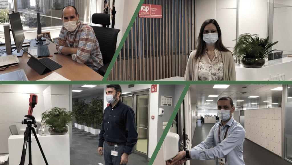 trabajadores de solunion con mascarilla en las oficinas